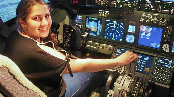IN CONTROL: Rebecca Hallahan in the cockpit of USQ's 737 flight simulator.