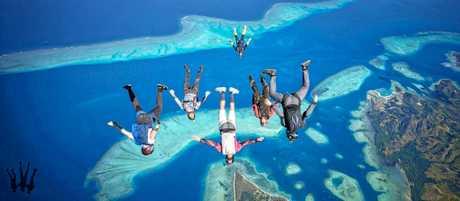 FLYING: Tweed Heads man Shane Turner (insert) will represent Australia in speed parachuting.