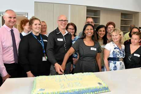 Cutting of the cake at the official opening of the Step Up Step Down mental health facility in Gladstone.