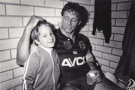 Football legend Mark Graham and his son Luke, who will direct a documentary about his father's life.