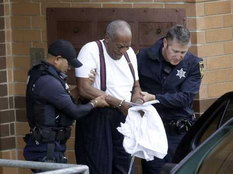 Bill Cosby is escorted out of the Montgomery County Correctional Facility, following his sentencing to three-to-10-year prison sentence for sexual assault. Picture: AP