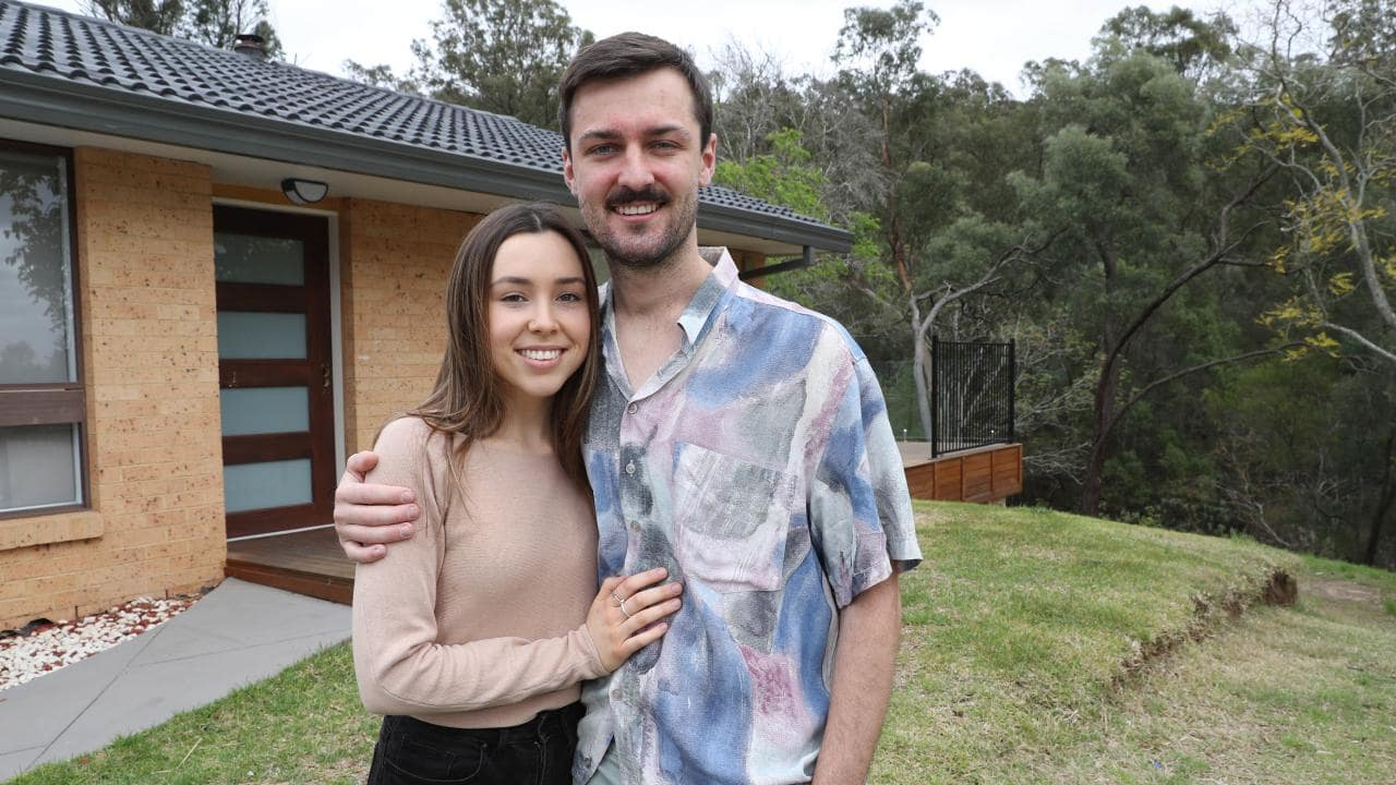 Jarrod Redmond, 23, and Rebecca Michelsen, 21, pose for a photo at their new home. Picture: AAP Image/David Swift