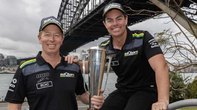 Bathurst winners Craig Lowndes and Steve Richards with the Peter Brock trophy.