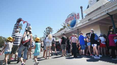 Visitors at the entrance to Dreamworld. Photo: Getty Images