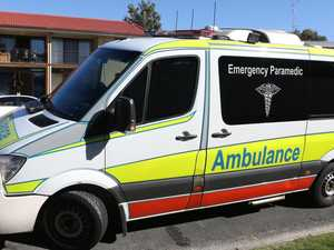 Tannum man taken to hospital after crashing into parked car
