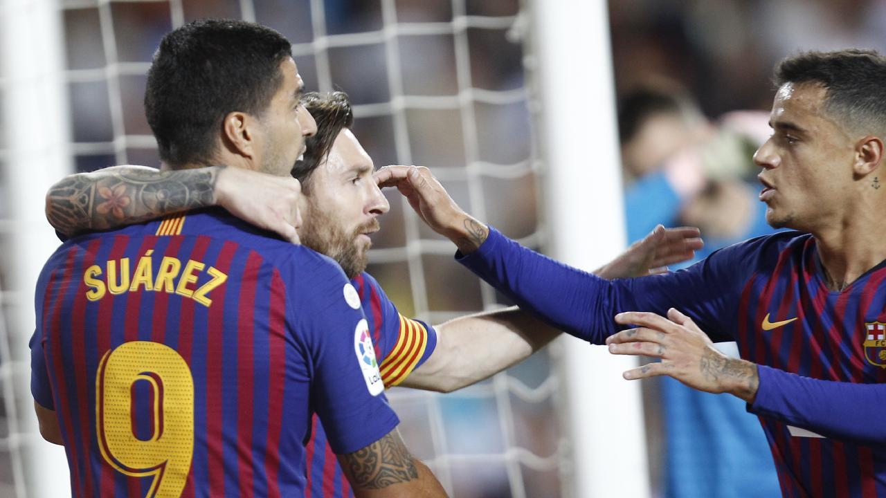 Messi celebrates with Suarez and Coutinho