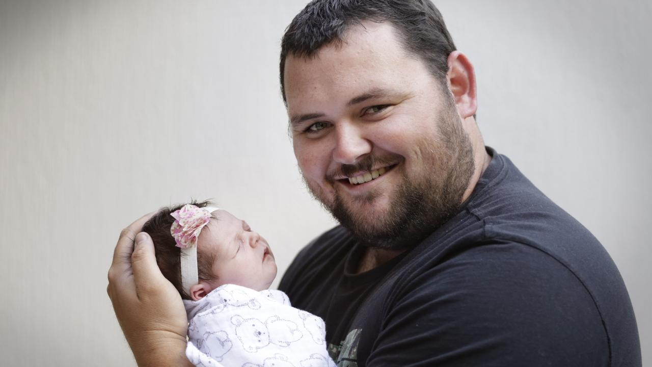 New dad Beau Rohweder enjoyed every moment of his skin-to-skin bonding with first child Elsie after her birth. Picture: AAP/Megan Slade