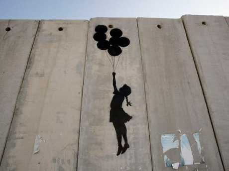 One of Banksy's works on the Israeli West Bank wall.