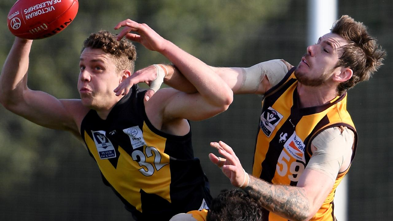 Josh Corbett is spoiled by Kaiden Brand in the VFL. Picture: Andy Brownbill