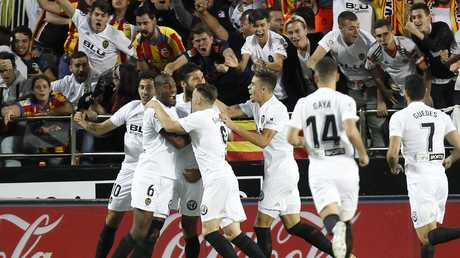 Ezequiel Garay netted the opener for Valencia.