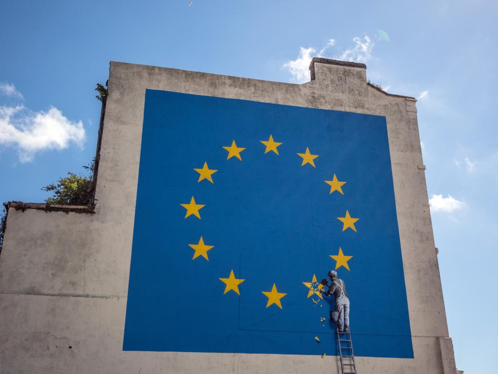 Another Banksy mural, depicting a workman chipping away at one of the stars on a European Union. Picture: Getty