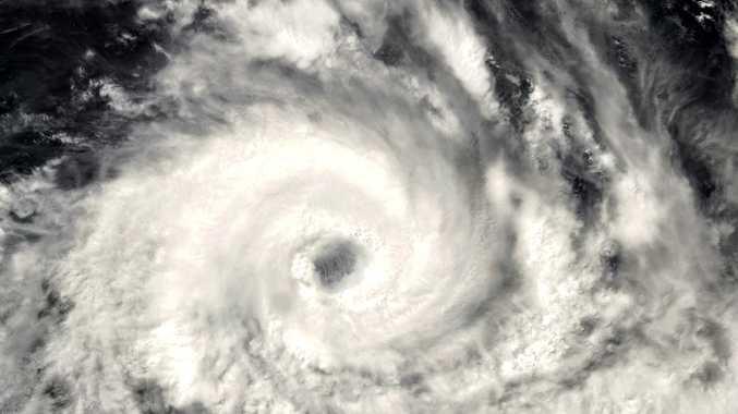Satellite image of Cyclone Debbie as it crosses the coastline of Queensland.
