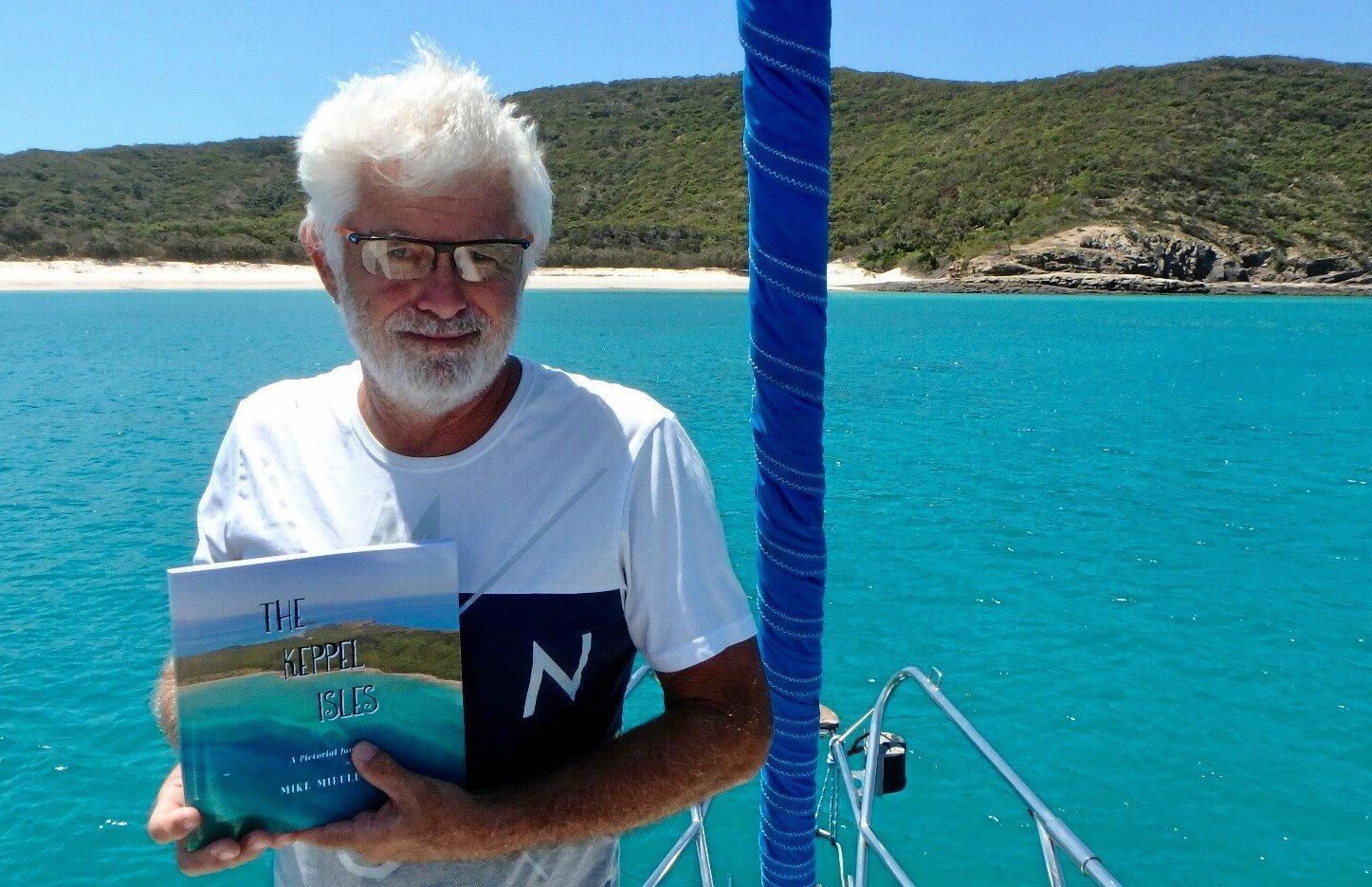 SMITTEN: Mike Middleton with his new book,  The Keppel Isles . INSET: Drone footage taken in Keppel Bay.