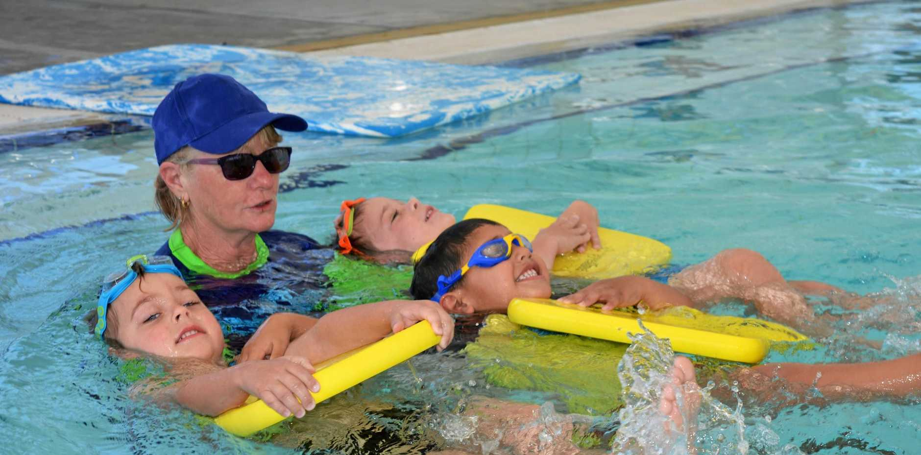 SKILLS: Ashton Porter, Jonah Volanaba and Clayton Kinsey learn to swim with instructor Jan Moy at LVSAC.