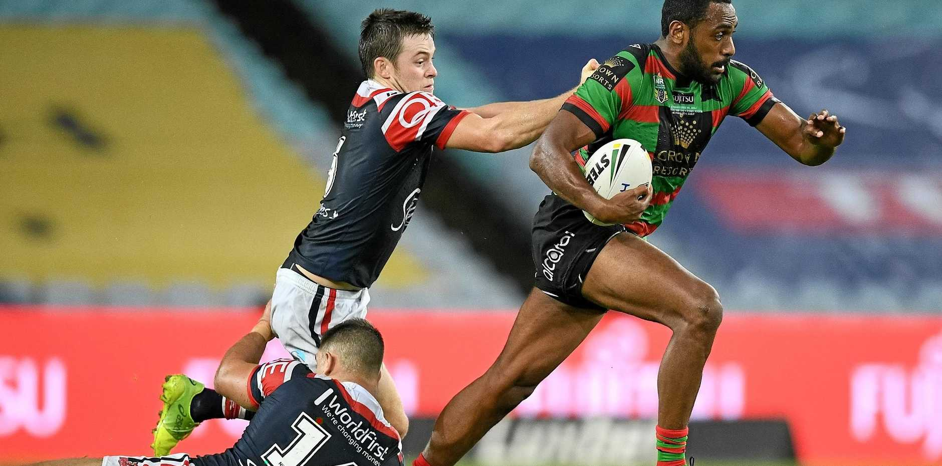 Sitiveni Moceidreke of the Rabbitohs is tackled by Luke Keary of the Roosters during the Round 4 NRL match between the South Sydney Rabbitohs and the Sydney Roosters at ANZ Stadium in Sydney, Thursday, March 23, 2017. (AAP Image/Dan Himbrechts) NO ARCHIVING, EDITORIAL USE ONLY