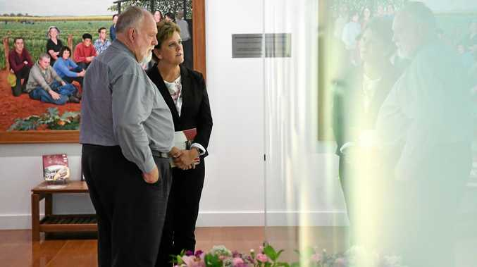 LIVES REMEMBERED: Cr Bill Trevor with British High Commissioner Menna Rawlings at the Childers backpackers memorial.