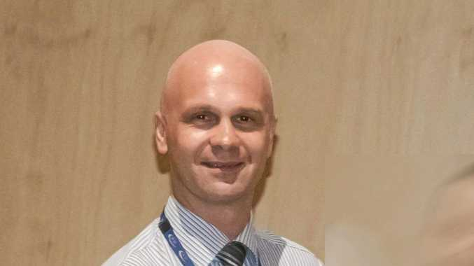 Dr Piotr Swierkowski has been stood down from his position at Sunshine Coast Hospital and Health Service following allegations he abused his wife.