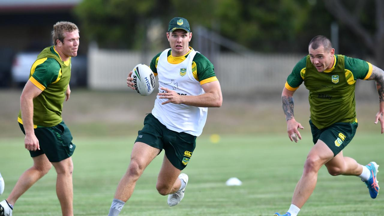 Tom Trbojevic (centre) gets past Jake Trbojevic (left) and David Klemmer (right) during a Kangaroos training session in Brisbane. Picture: AAP