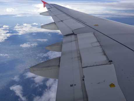Spot the yellow hooks on the plane wing.