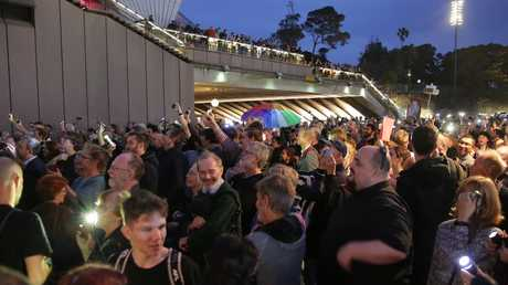 Pictured outside the Sydney Opera House are protesters trying to disrupt the lights with their own torches. Picture: Christian Gilles