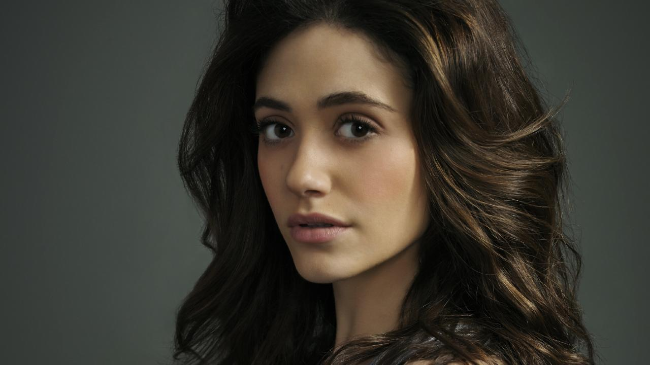Emmy Rossum, now well-versed on the use of a 'vag pad.'