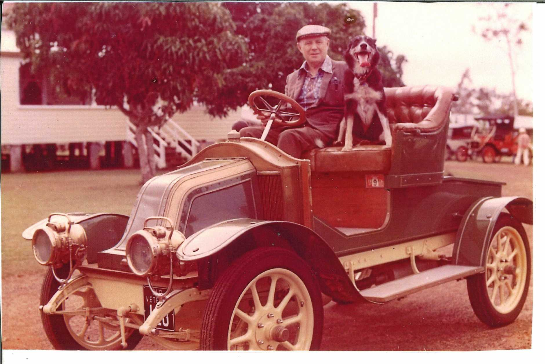 The late Sam Hecker, former patron of the Fraser Coast Historic Vehicle Club, with his dog sitting in his restored Didion.