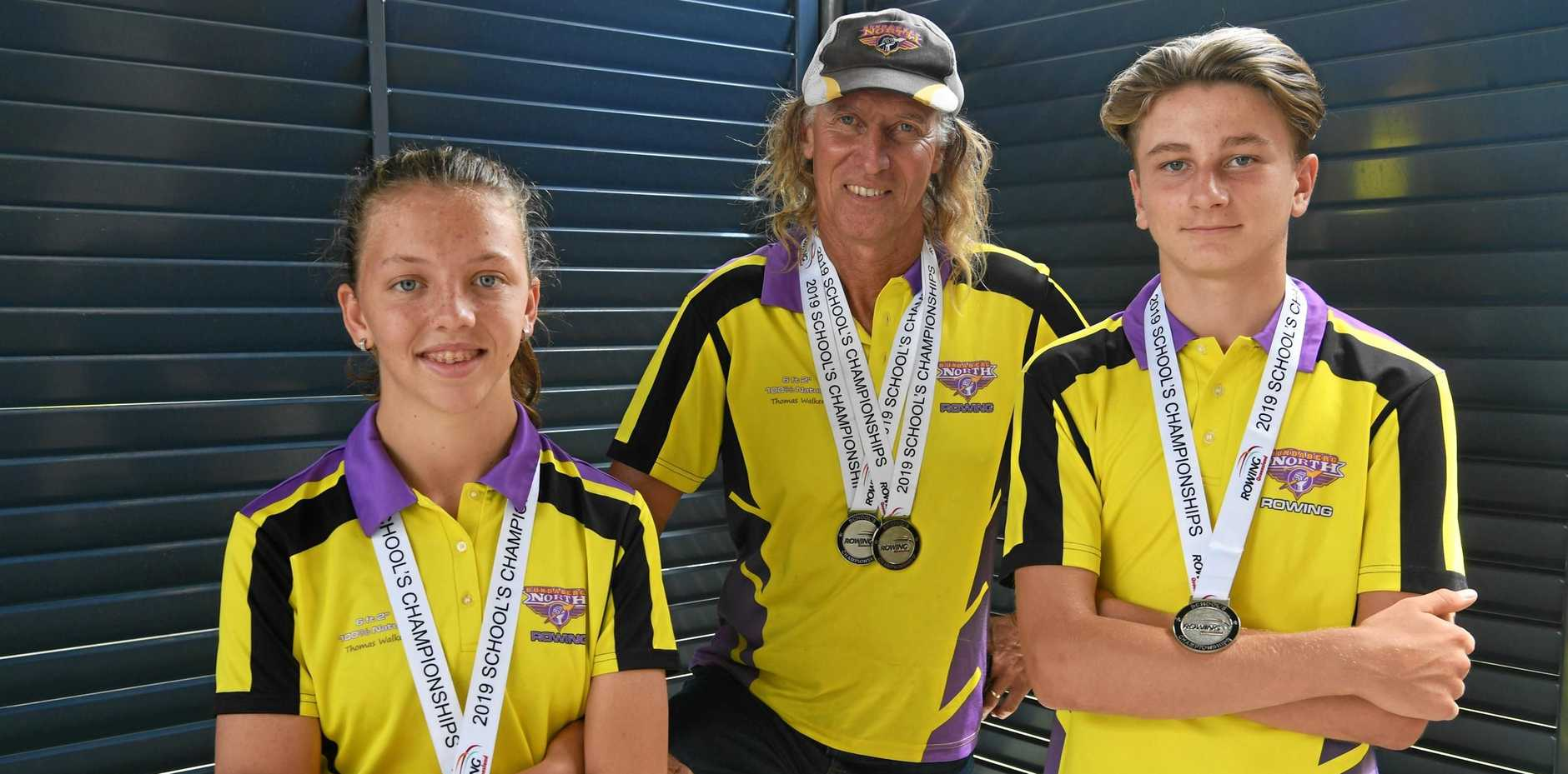 Jayne Wake, coach Tom Laven and Saxon Blair with their medals from the rowing championships.