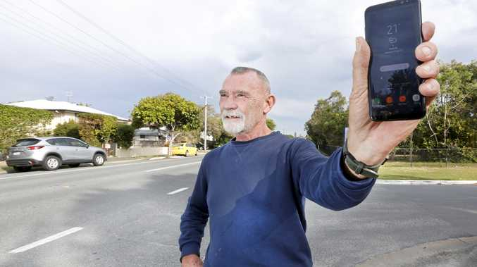 Gregg Miller with his mobile phone looking for coverage in Pottsville.