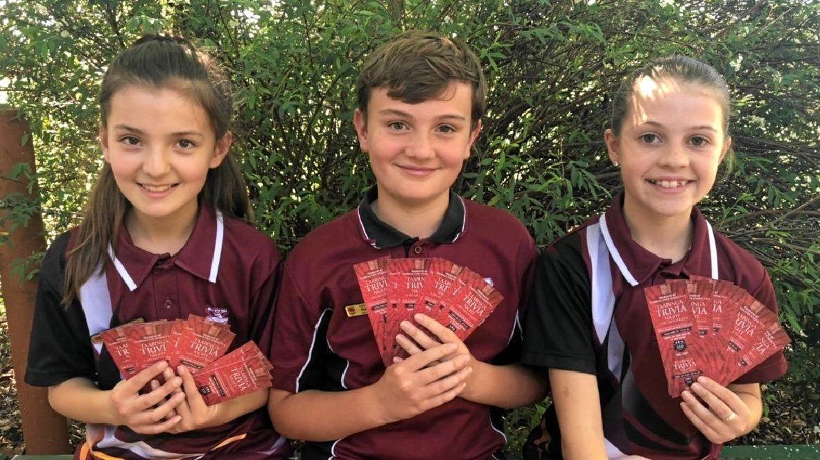 Tiarna Petersen-Jiamtsu, Walter Sawtell and Mackinzie Campbell holding tickets for Taabinga's upcoming 'Splash of Red' trivia night!