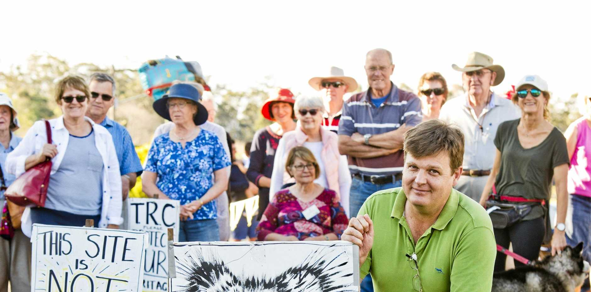 NOT HAPPY: Geoff Sharp and other residents meet about the housing development on Rifle Range Rd by DHA.