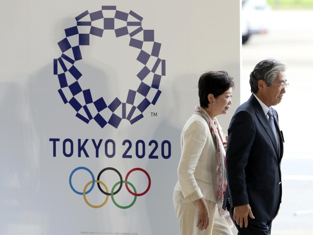 Tokyo Governor Yuriko Koike and Tsunekazu Takeda, president of the Japanese Olympic Committee. (AP Photo/Eugene Hoshiko, File)