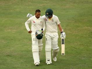 Usman Khawaja and Travis Head after their courageous fightback.