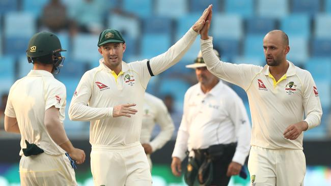 DUBAI, UNITED ARAB EMIRATES - OCTOBER 09: Nathan Lyon of Australia celebrates after taking the wicket of Bilal Asif of Pakistan during day three of the First Test match in the series between Australia and Pakistan at Dubai International Stadium on October 09, 2018 in Dubai, United Arab Emirates. (Photo by Ryan Pierse/Getty Images)