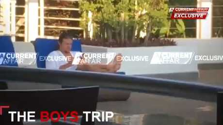 "Nick living ""the bachelor lifestyle"" aka sitting by the pool"