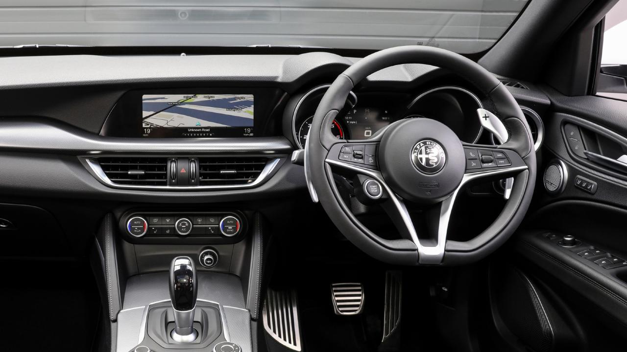 The Stelvio's cabin compares well with other luxury SUVs, but its digital instrument display is sub-par.