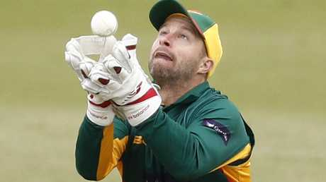 Tasmanian wicketkeeper Matthew Wade catches Victoria's Cameron White. Picture: AAP