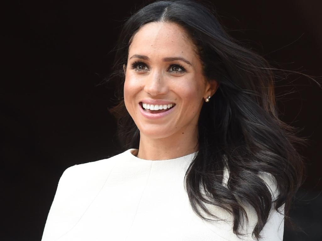 Regardless of who she wears, Meghan's personal style will be hugely influential to Australian women. Picture: Eddie Mulholland/WPA Pool/Getty Images