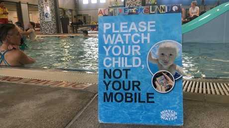 A Brunswick Baths sign reminds parents to be parents.