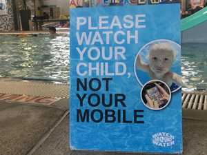 Parents told to put down phones at pool
