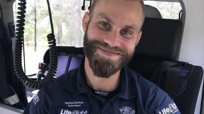 LifeFlight Critical Care doctor, Dr Oskar Larsson can be seen nursing the new bub