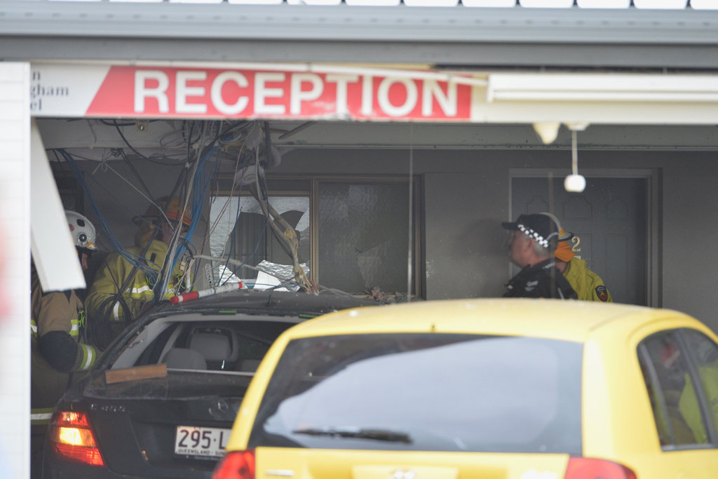 Emergency services at the Allan Cunningham Motel on Ruthven St where a car smashed into the building in Kearneys Spring.