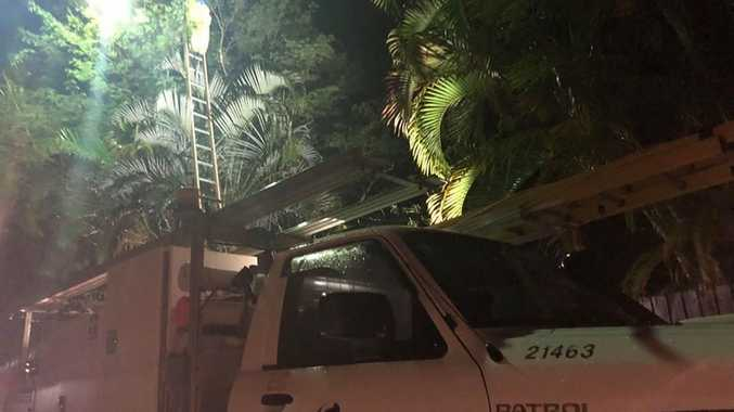 ON SCENE: An Ergon Energy electrician works to restore power to a home on Leslie Avenue in Scarness after reports a home was struck by lightning.