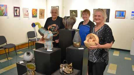 CLAY DISPLAY: Mudlark members (from left) Audrey Reece, Judith Miosge and Barbara Ritchie with some of their artworks on exhibition at Maryborough Art Gallery.