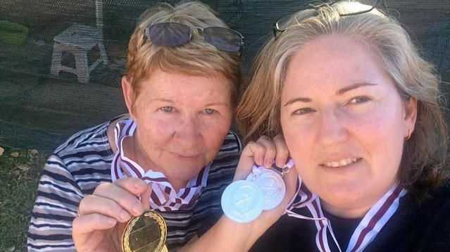 Ann Bruton and Miriam Blythe show off their medals for shooting