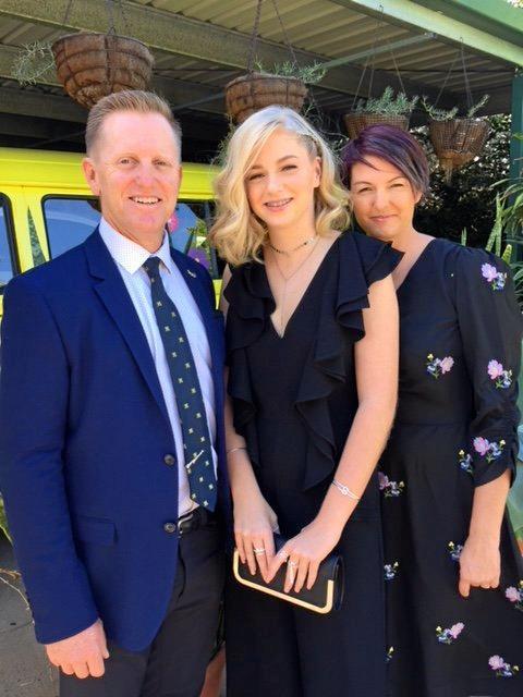 Allan, Olivia, and Beverley Harwood at Olivia's formal.
