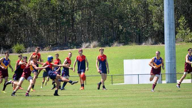 WINDOWS OF OPPORTUNITY: Jonty MacDougall kicks forward for the Darling Downs Demons against Moreton Bay during the U16 South Country Carnival earlier this year.