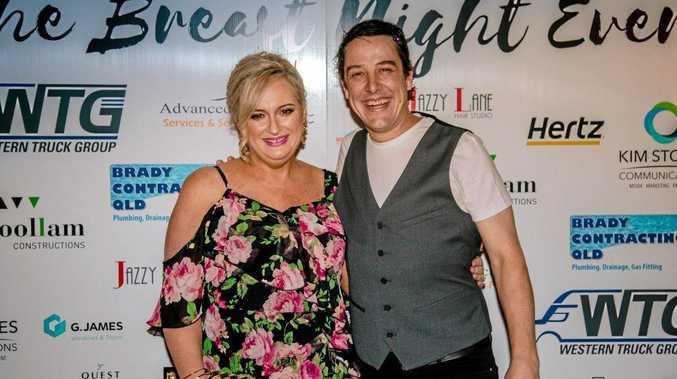 SUCCESS: Breast Night Ever event organiser Paula Lucas enjoying the evening with Love Your Sister's Sam Johnson.