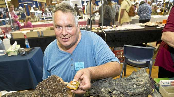 WHAT A GEM: David Bissett holds a Queensland agate at last year's Gemfest. This stone and many others will be available at this year's expo.
