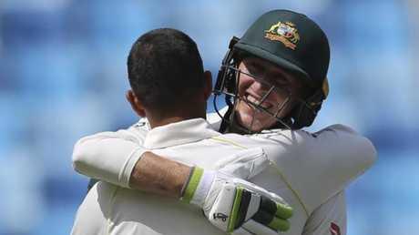 Australian debutant Marnus Labuschagne hugs Usman Khawaja after Khawaja brought up his century.