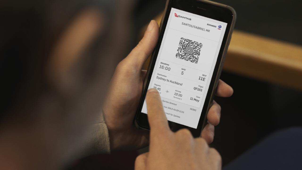 Qantas's digital boarding passes. Picture: Andreas Smetana